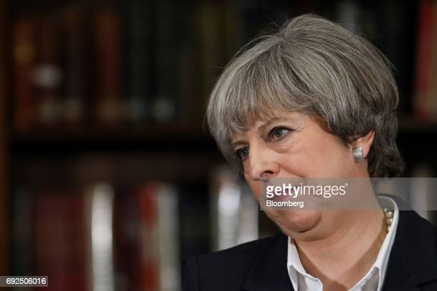 Theresa May UK prime minister and leader of the Conservative Party pauses after delivering a speech at the Royal United Services Institute in London...