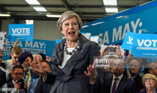 Theresa May UK prime minister and leader of the Conservative Party gestures while speaking at a generalelection campaign event in Slough UK on...