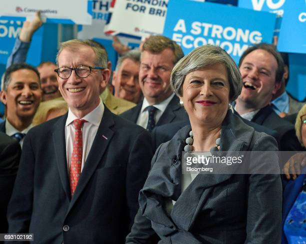 Theresa May UK prime minister and leader of the Conservative Party right and her husband Philip May attend a generalelection campaign event in Slough...