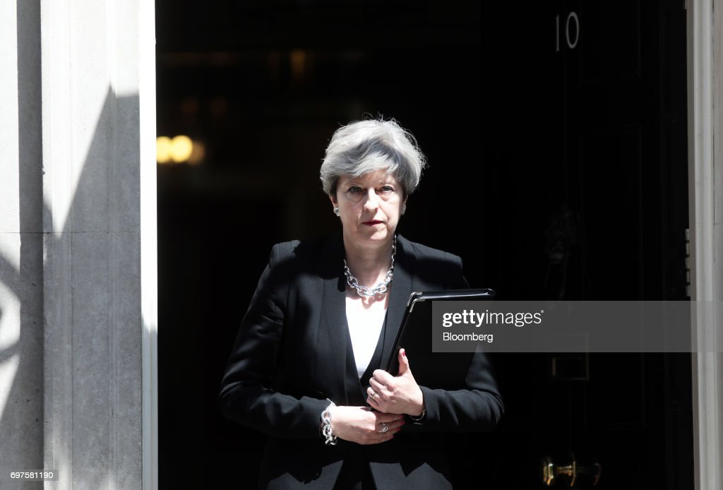 Theresa May, U.K. prime minister, arrives to deliver a statement outside number 10 Downing Street, in London, U.K., on Monday, June 19, 2017. U.K. police are treating an incident in which a van plowed into a crowd outside a north London mosque as the third terrorist attack on the capital in as many months. Photographer: Simon Dawson/Bloomberg via Getty Images