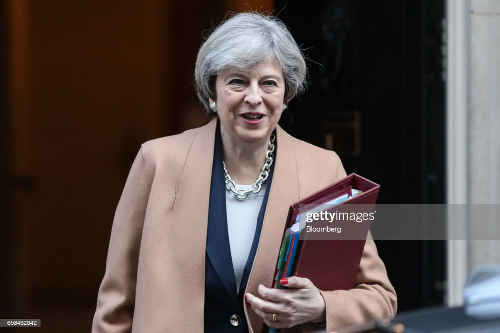 Theresa May, U.K. prime minister, carries a document folder as she leaves 10 Downing Street to attend the weekly question-and-answer session in the House of Commons, in London, U.K., on Wednesday, March 15, 2017. The European Union is considering forcing the U.K. to wait until June for formal negotiations to begin on the terms of Brexit, eroding the time May has to land a deal, according to EU officials. Photographer: Simon Dawson/Bloomberg via Getty Images