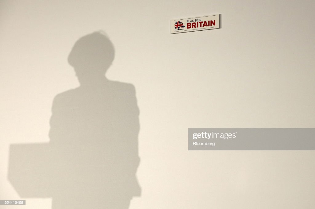 Theresa May, U.K. prime minister, casts a shadow on the wall of the podium at the Conservative Party's annual Spring Forum in Cardiff, U.K., on Friday, March 17, 2017. May will pledge to forge a closer union within the U.K. in a rebuke to Scottish National Party leader Nicola Sturgeon, who started the week calling for a new independence referendum for Scotland. Photographer: Simon Dawson/Bloomberg via Getty Images