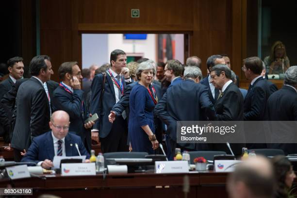 Theresa May UK prime minister center looks on ahead of roundtable talks with European Union leaders in Brussels Belgium on Thursday Oct 19 2017 May...