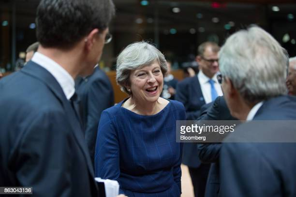 Theresa May UK prime minister center reacts as she meets Paolo Gentiloni Italy's prime minister right and Mark Rutte Netherlands prime minister ahead...