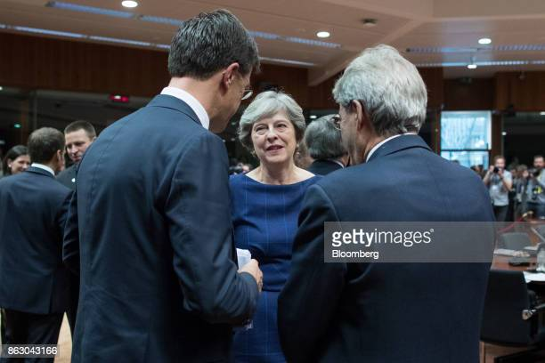 Theresa May UK prime minister center speaks with Mark Rutte Netherlands prime minister left and Paolo Gentiloni Italy's prime minister ahead of...