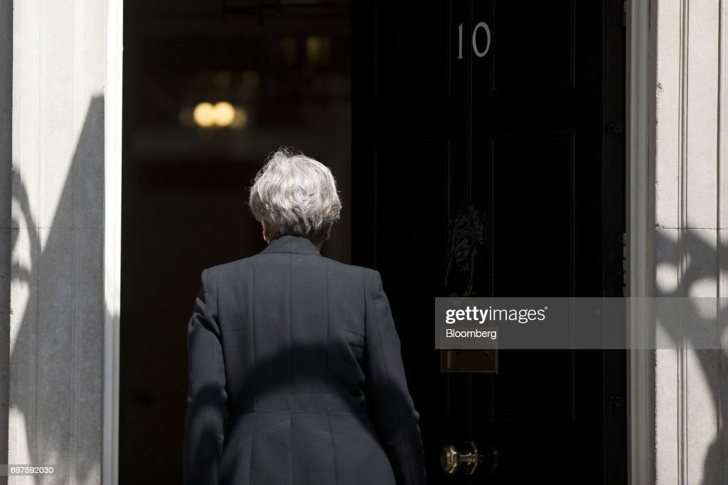 Theresa May, U.K. prime minister, departs after delivering a statement outside number 10 Downing Street, in London, U.K., on Monday, June 19, 2017. U.K. police are treating an incident in which a van plowed into a crowd outside a north London mosque as the third terrorist attack on the capital in as many months. Photographer: Simon Dawson/Bloomberg via Getty Images