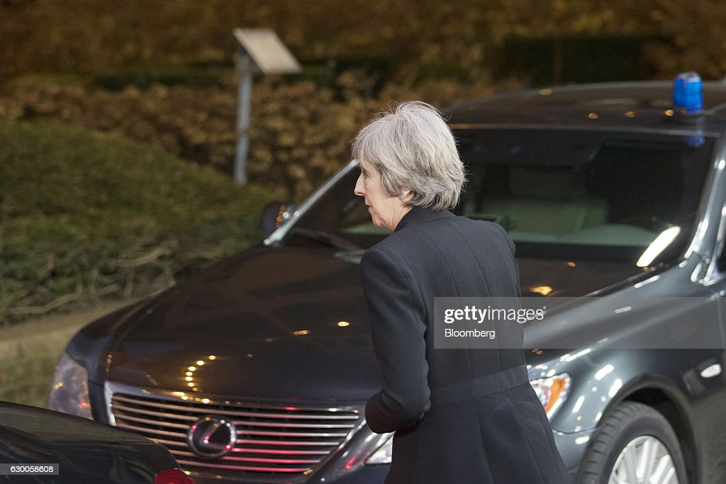 Theresa May, U.K. prime minister, leaves after meeting with European Union (EU) leaders in Brussels, Belgium, on Thursday, Dec. 15, 2016. A first glimpse of the European Union's potential for disunity on Brexit emerged at the Brussels summit, as EU leaders were caught up in a dispute over how the bloc negotiates with the U.K. as it heads for the door. Photographer: Jasper Juinen/Bloomberg via Getty Images