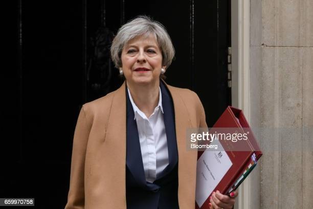 Theresa May UK prime minister leaves number 10 Downing Street on her way to speak in the House of Commons in London UK on Wednesday March 29 2017 The...