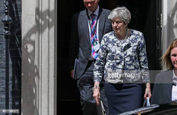 Theresa May UK prime minister leaves number 10 Downing Street on her way to parliament in London UK on Monday June 26 2017 Mayis to pad out her plan...