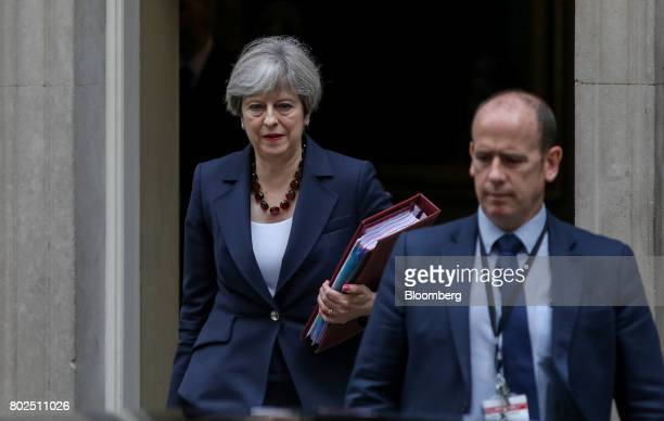Theresa May UK prime minister leaves number 10 Downing Street on her way to attend the weekly question and answer session in Parliament in London UK...