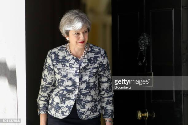 Theresa May UK prime minister leaves number 10 Downing Street to greet Arlene Foster leader of the Democratic Unionist Party in London UK on Monday...
