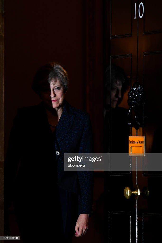 Theresa May, U.K. prime minister, leaves number 10 Downing Street to greet Scotland's First Minister Nicola Sturgeon, in London, U.K., on Tuesday, Nov. 14, 2017. Tory rebels threatening to force Mayto change her Brexit policy will hold their fire at a marathon parliamentary session on Tuesday as the government has used its control of the timetable to push back the most controversial debates. Photographer: Chris J. Ratcliffe/Bloomberg via Getty Images
