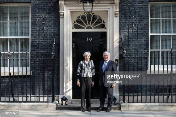 Theresa May UK prime minister left and Antonio Tajani president of the European Parliament pose for photographers outside number 10 Downing Street in...