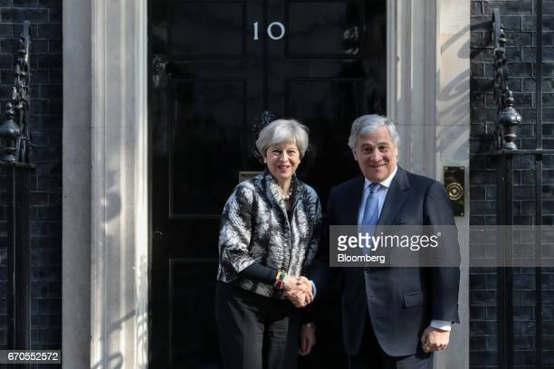 Theresa May UK prime minister left and Antonio Tajani president of the European Parliament shake hands outside number 10 Downing Street in London UK...