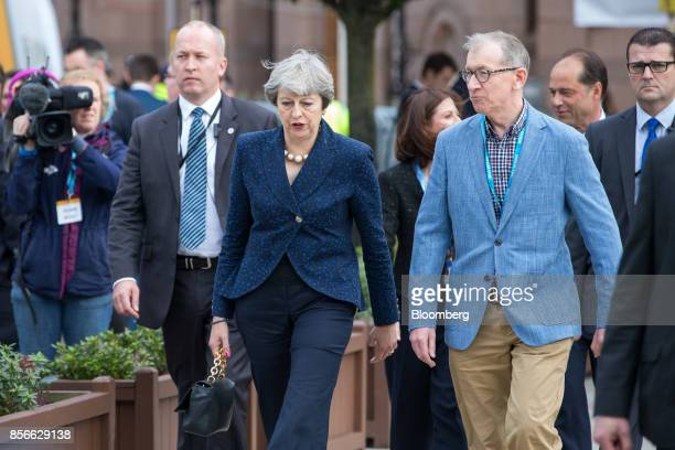 Theresa May UK prime minister left and her husband Philip arrive at the annual Conservative Party conference in Manchester UK on Monday Oct 2 2017 UK...