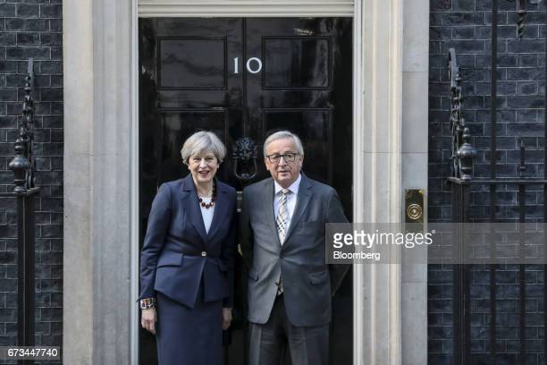 Theresa May UK prime minister left and JeanClaude Juncker president of the European Commission pose for photographers outside number 10 Downing...