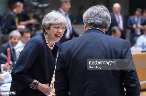 Theresa May UK prime minister left greets Antonio Tajani president of the European Parliament ahead of round table talks during the European Union...
