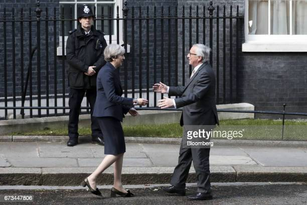 Theresa May UK prime minister left greets JeanClaude Juncker president of the European Commission outside number 10 Downing Street in London UK on...