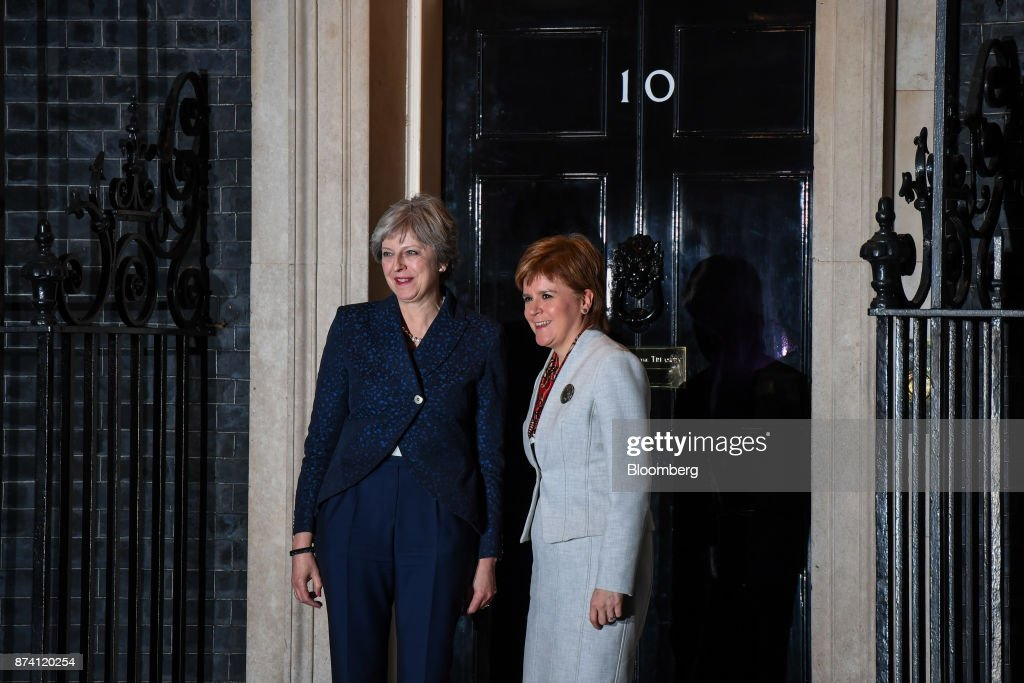 Theresa May, U.K. prime minister, left, poses for a photograph with Nicola Sturgeon, Scotland's first minister, at outside number 10 Downing Street in London, U.K., on Tuesday, Nov. 14, 2017. Tory rebels threatening to force Mayto change her Brexit policy will hold their fire at a marathon parliamentary session on Tuesday as the government has used its control of the timetable to push back the most controversial debates. Photographer: Chris J. Ratcliffe/Bloomberg via Getty Images