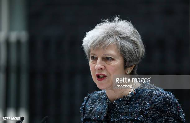 Theresa May UK prime minister makes a statement to the media outside number 10 Downing Street after meeting Queen Elizabeth II to mark the...