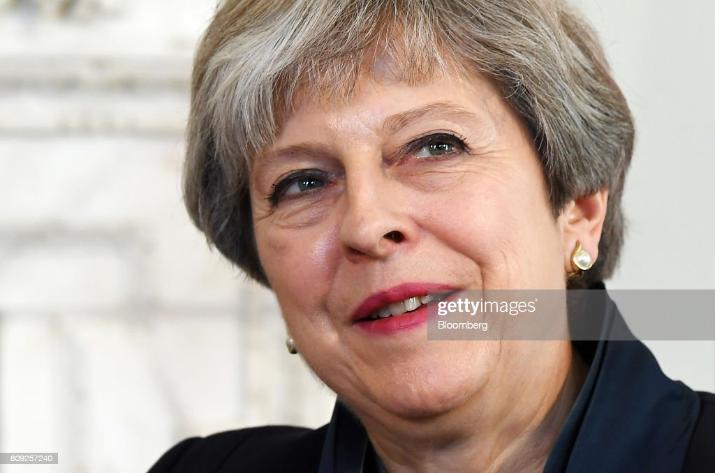 Theresa May, U.K. prime minister, meets with Volodymyr Hroisman, Ukraine's prime minsiter, (not pictured) inside number 10 Downing Street in London, U.K., on Wednesday, July 5, 2017. Under pressure to drop austerity, Mayrefused to buckle to calls from the opposition and some of her senior Conservative ministers to drop the pay cap for public sector workers. Photographer: Andy Rain/Pool via Bloomberg