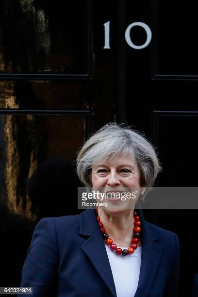 Theresa May UK prime minister poses for a photograph outside 10 Downing Street in London UK on Friday Feb 17 2017 Former UK Prime Minister Tony Blair...