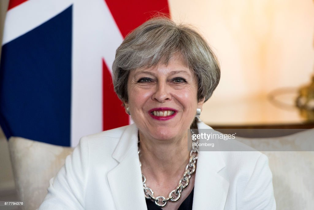 Theresa May, U.K. prime minister, reacts during her bilateral meeting with Estonia's Prime Minister Juri Rata (not pictured) inside number 10 Downing Street in London, U.K., on Tuesday, July 18, 2017. May is being encouraged to fire disloyal ministers who risk tearing the government apart and handing power to Labour's Jeremy Corbyn. Photographer: Will Oliver/Pool via Bloomberg
