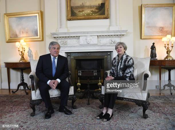 Theresa May UK prime minister right and Antonio Tajani president of the European Parliament poses for photographers ahead of their meeting inside...