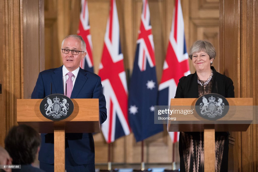 Theresa May, U.K. prime minister, right, reacts during a joint news conference with Malcolm Turnbull, Australia's prime minister inside number 10 Downing Street in London, U.K., on Monday, July 10, 2017. May came under fire from her own party over the weekend as she prepared to publish a draft law this week intended to repeal the U.K.'s membership of the EU, and set a new legal framework for the country after it withdraws from the bloc. Photographer: Jason Alden/Bloomberg via Getty Images