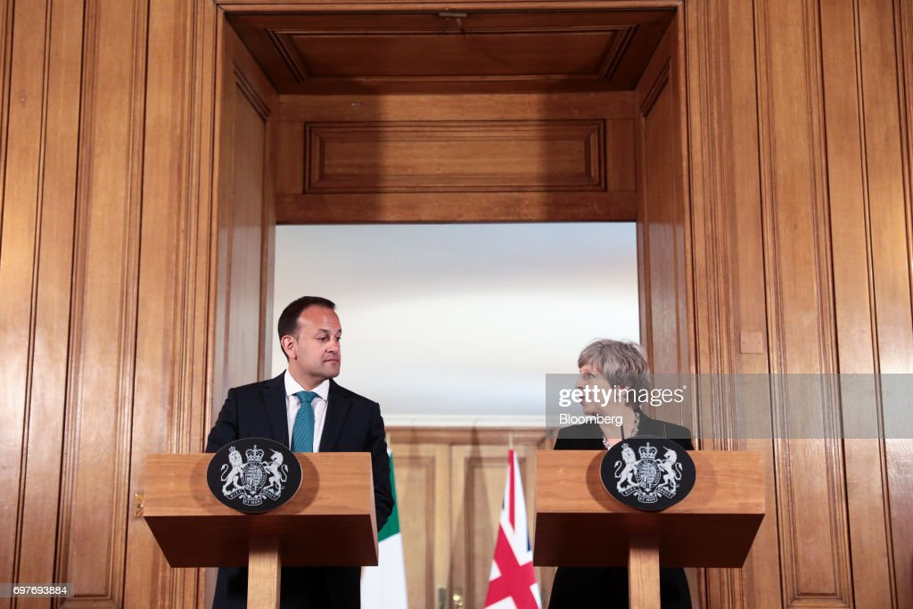 Theresa May, U.K. prime minister, right, speaks as Leo Varadkar, Ireland's prime minister, looks on during a joint news conference inside number 10 Downing Street in London, U.K., on Monday, June 19, 2017. TheRepublic of Irelandis the Northern Ireland's biggest trading partner outside Britain. Photographer: Simon Dawson/Bloomberg via Getty Images