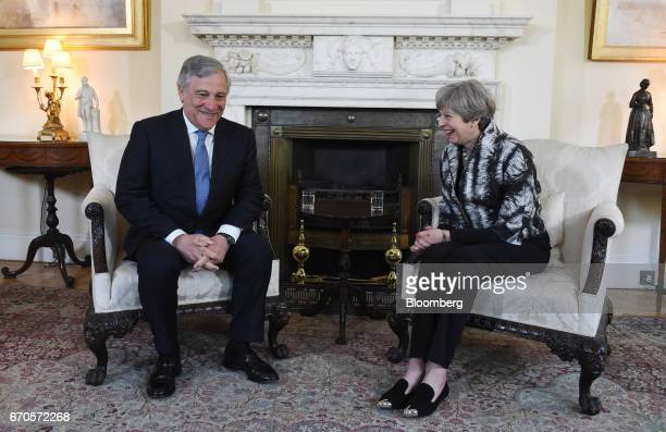 Theresa May UK prime minister right speaks with Antonio Tajani president of the European Parliament during their meeting inside number 10 Downing...
