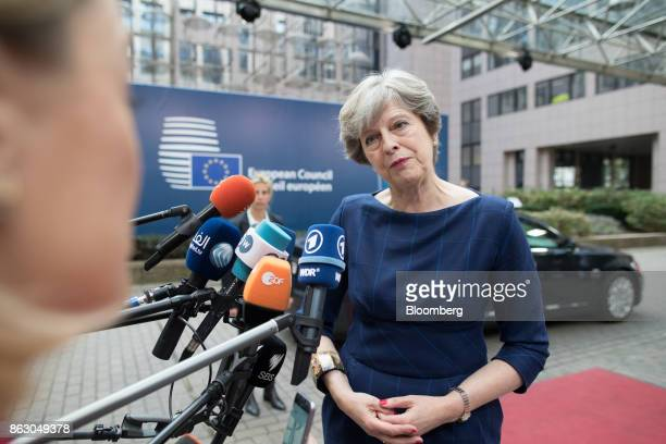 Theresa May UK prime minister speaks to journalists as she arrives for a meeting of European Union leaders in Brussels Belgium on Thursday Oct 19...