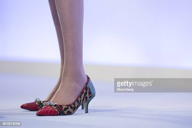 Theresa May UK prime minister stands in leopardprint kittenheel shoes as she speaks at the Confederation of British Industry annual conference in...