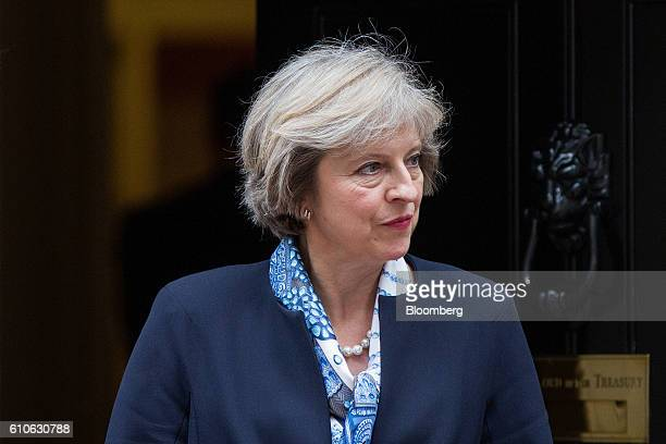 Theresa May UK prime minister waits to greet Nicos Anastasiades Cyprus's president outside number 10 Downing Street in London UK on Tuesday Sept 27...