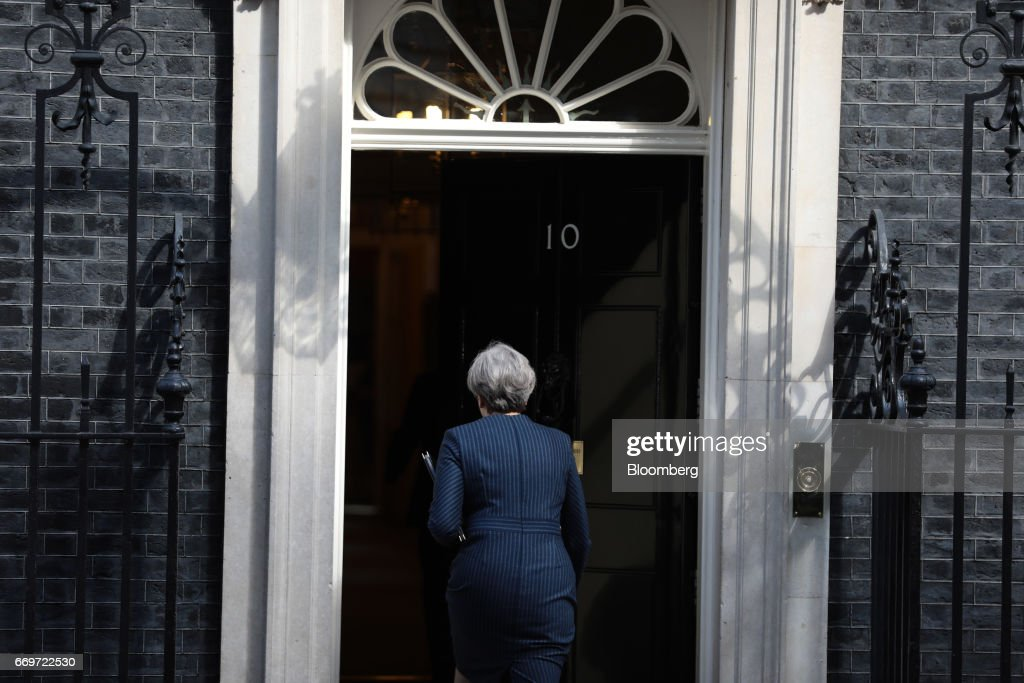 Theresa May, U.K. prime minister, walks into 10 Downing Street after announcing a general election in London, U.K., on Tuesday, April 18, 2017. May said she will seek an early election on June 8, in an unexpected gamble aimed at strengthening her hand going into talks on leaving the European Union. Photographer: Simon Dawson/Bloomberg via Getty Images