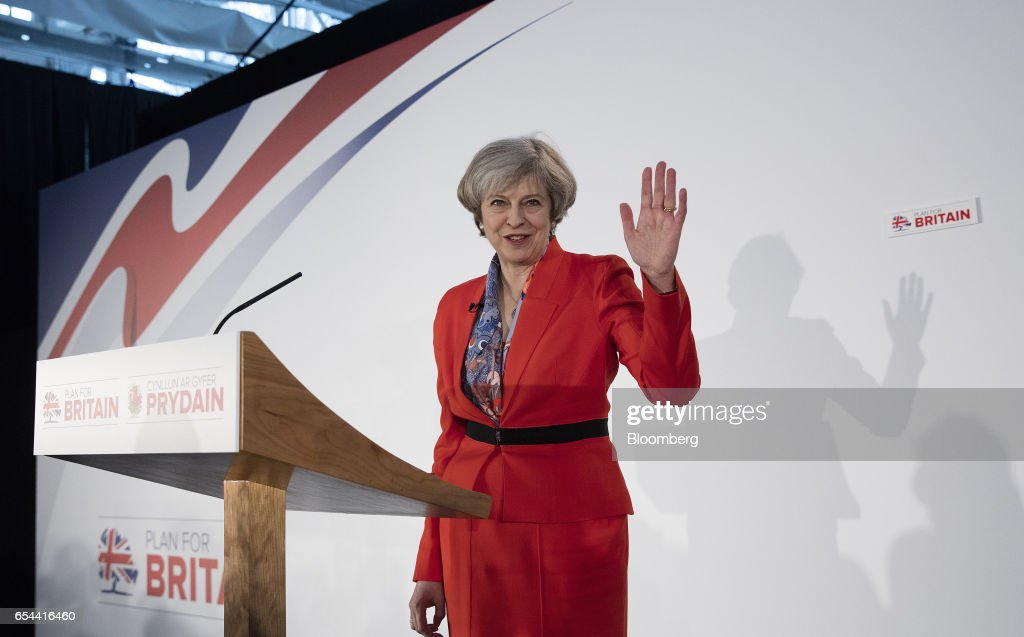 Theresa May, U.K. prime minister, waves as she arrives to speak at the Conservative Party's annual Spring Forum in Cardiff, U.K., on Friday, March 17, 2017. May will pledge to forge a closer union within the U.K. in a rebuke to Scottish National Party leader Nicola Sturgeon, who started the week calling for a new independence referendum for Scotland. Photographer: Simon Dawson/Bloomberg via Getty Images