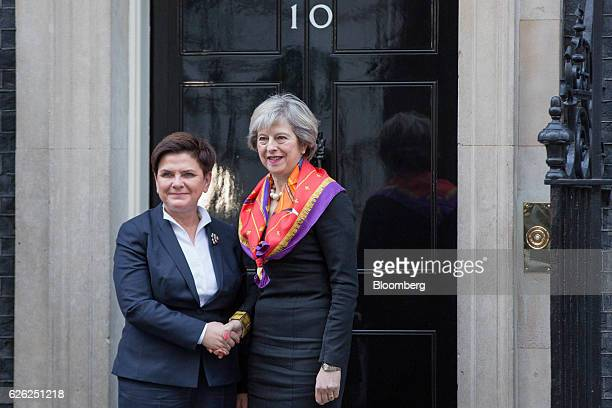Theresa May UK's prime minister right greets Beata Szydlo Poland's prime minister outside 10 Downing Street in London UK on Monday Nov 28 2016 May...