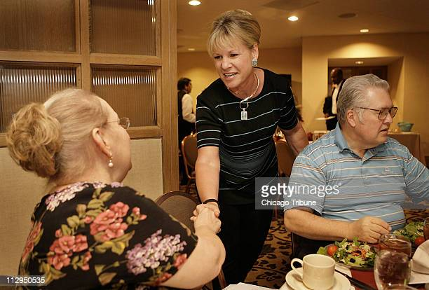 Theresa Metty speaks with Janell Cormier prior to speaking at the National Association of Purchasing Management's dinner in Houston Texas September...