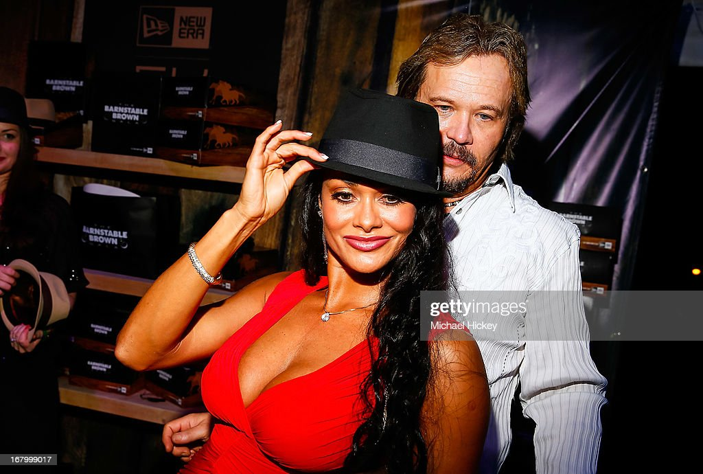 Theresa Nelson and <a gi-track='captionPersonalityLinkClicked' href=/galleries/search?phrase=Travis+Tritt&family=editorial&specificpeople=215125 ng-click='$event.stopPropagation()'>Travis Tritt</a> try on hats at theNew Era Cap tent at The Barnstable Brown Gala on May 3, 2013 in Louisville, Kentucky.