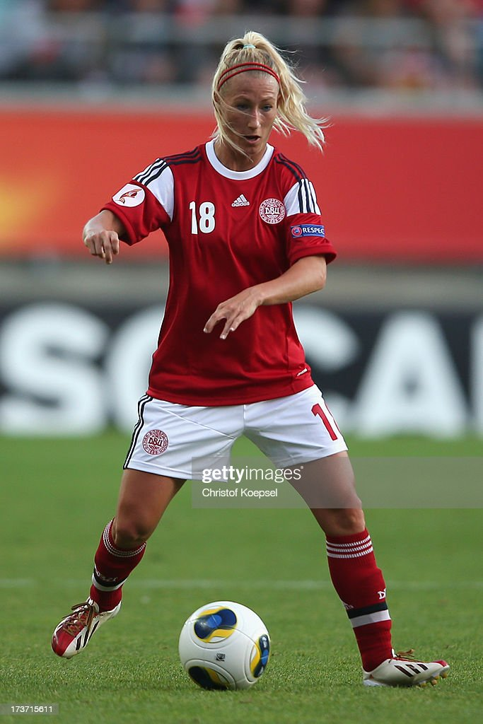 Theresa Nielsen of Denmark runs with the ball during the UEFA Women's EURO 2013 Group A match between Denmark and Finland at Gamla Ullevi Stadium on July 16, 2013 in Gothenburg, Sweden.