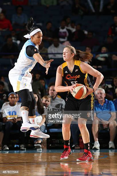 Theresa Plaisance of the Tulsa Shock looks to pass against Tamera Young of the Chicago Sky on September 11 2015 at the Allstate Arena in Rosemont...