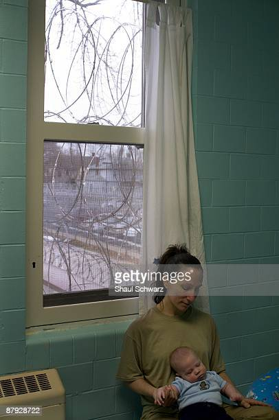 Theresa Tullis holds her baby Reese Tullis while sitting on her bed in her jail cell at the Indiana Women's Prison on March 24 2009 in Indianapolis...
