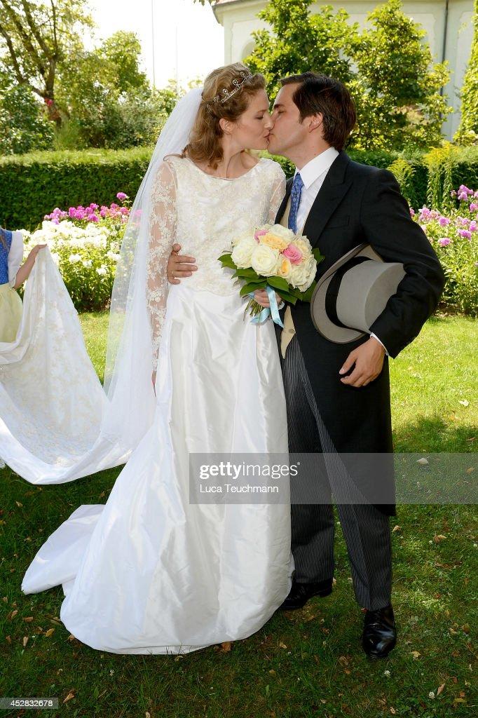 Theresa von Einsiedel and Prince Francois von Orleans depart from their wedding ceremony on July 26, 2014 in Straubing, Germany.