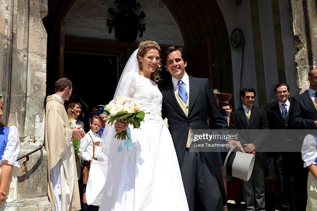 Theresa von Einsiedel and Prince Francois von Orleans depart from the wedding ceremony of wedding of Prince Francois von Orleans and Theresa von Einsiedel on July 26, 2014 in Straubing, Germany.