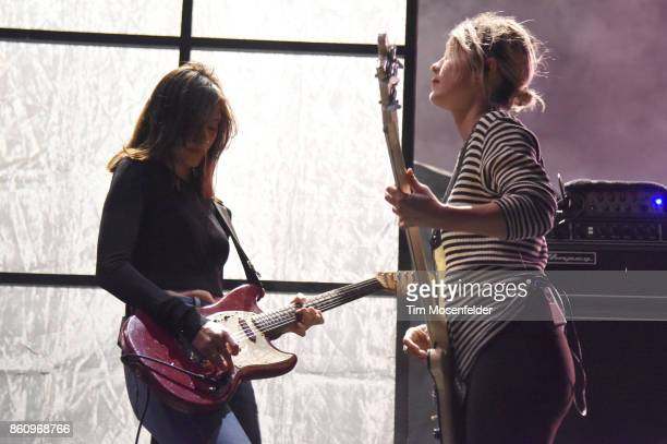Theresa Wayman and Jenny Lee Lindberg of Warpaint perform during the 'Global Spirit Tour' at ORACLE Arena on October 10 2017 in Oakland California