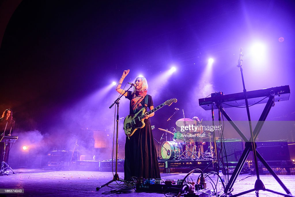 Theresa Wayman, Emily Kokal and Stella Mozgawa of Warpaint perform on stage at Brixton Academy on October 30, 2013 in London, England.