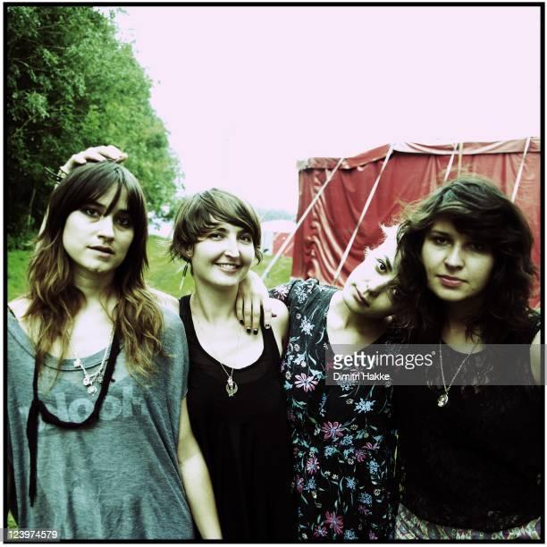 Theresa Wayman Emily Kokal Jenny Lee Lindberg and Stella Mozgawa of Warpaint pose backstage at Lowlands Festival on August 21 2011 in Biddinghuizen...
