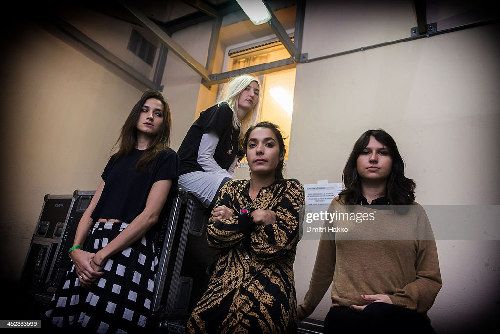 Theresa Wayman Emily Kokal Jenny Lee Lindberg and Stella Mozgawa of Warpaint pose backstage at Crossing Border Festival on November 16 2013 in The...