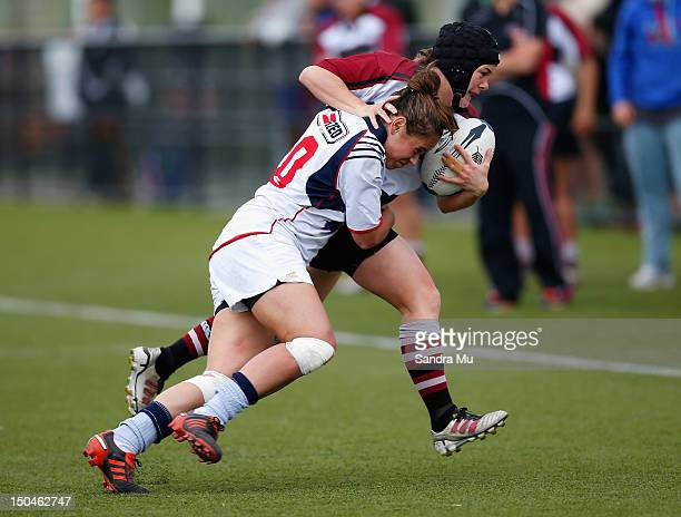 Therese Fitzpatrick of Auckland White tackles Emma Jensen of North Harbour during the Regional Women's Sevens Tournament Northern Region at College...