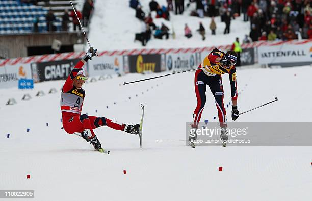 Therese Johaug of Norway and Justyna Kowalczyk of Poland finish the race during the women's 5km pursuit of the FIS World Cup Cross Country on March...